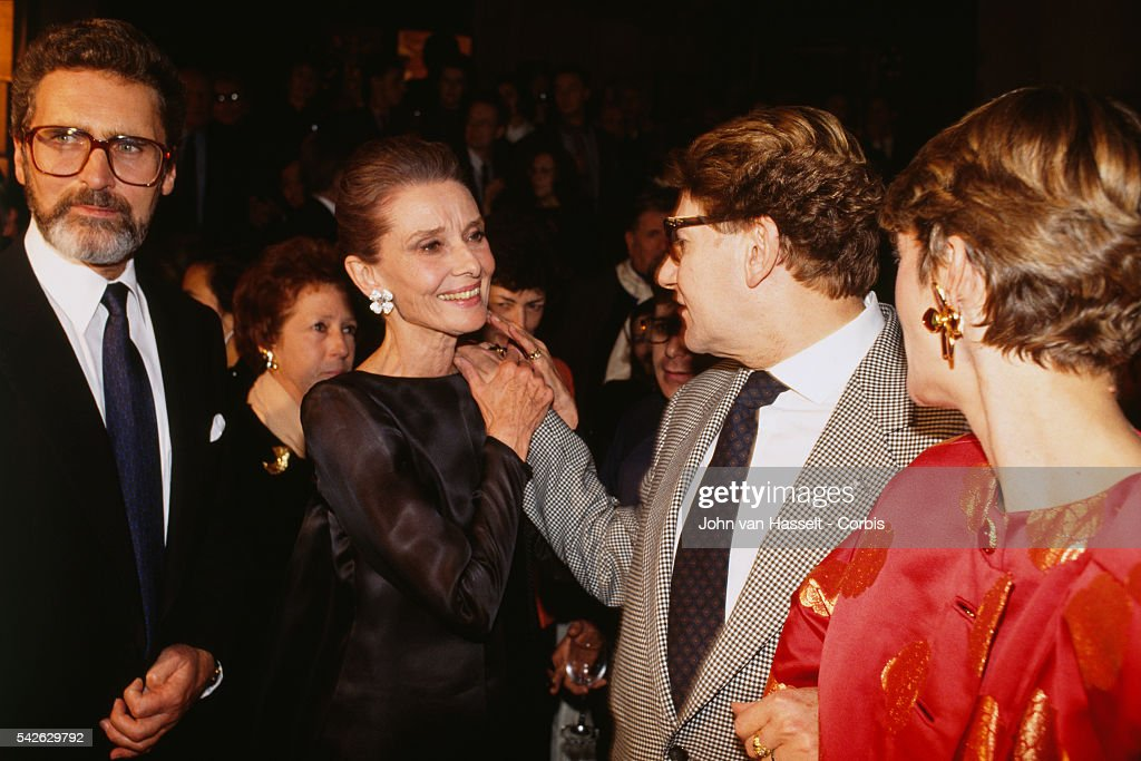 Audrey Hepburn and Yves Saint Laurent attend an exhibition at the Galliera Museum to celebrate the 40 years of fashion house Givenchy.