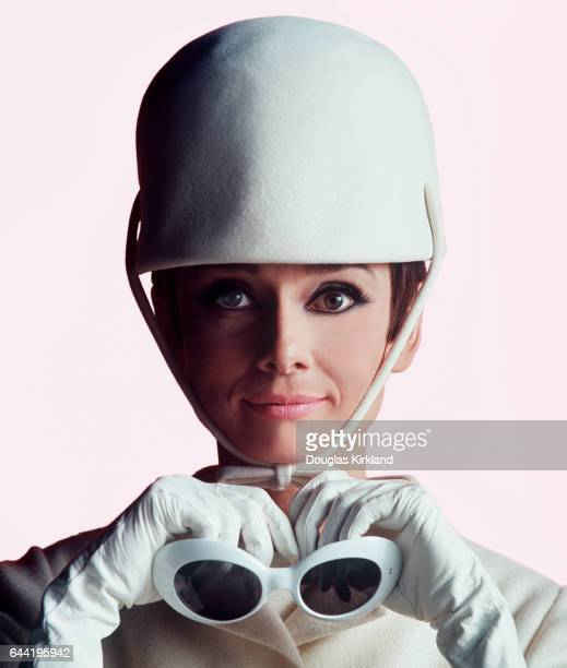 Audrey Hepburn at the Studio de Boulogne during the making of How to Steal a Million in Paris She wears a white Givenchy hat and and holds a pair of...