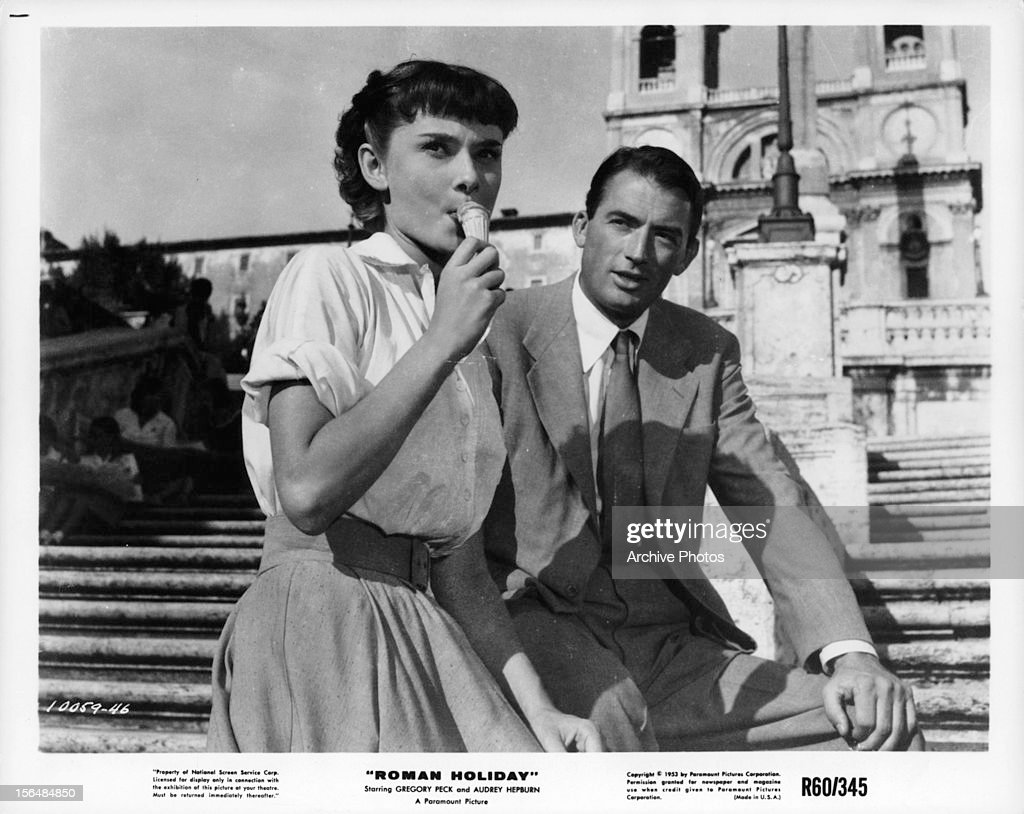 Audrey Hepburn eats gelato with Gregory Peck in a scene from the film 'Roman Holiday', 1953.