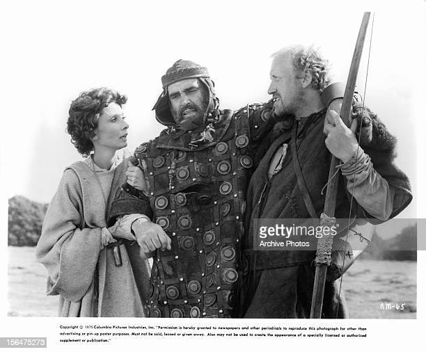 Audrey Hepburn helps Sean Connery along with Richard Harris in a scene from the film 'Robin And Marian' 1976
