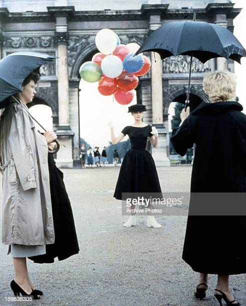 Audrey Hepburn holds balloons in a scene from the film 'Funny Face' 1957