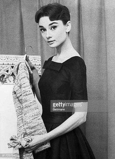 Audrey Hepburn Hollywood film star is tied for fifth place with Marlene Dietrich on the 1956 list of the World's Best Dressed Women made public today...