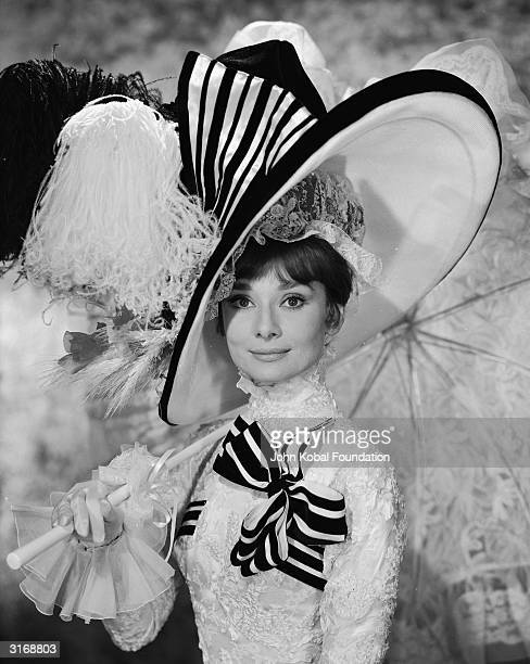 Audrey Hepburn in extravagant frills and hat as Eliza Doolittle in 'My Fair Lady' directed by George Cukor