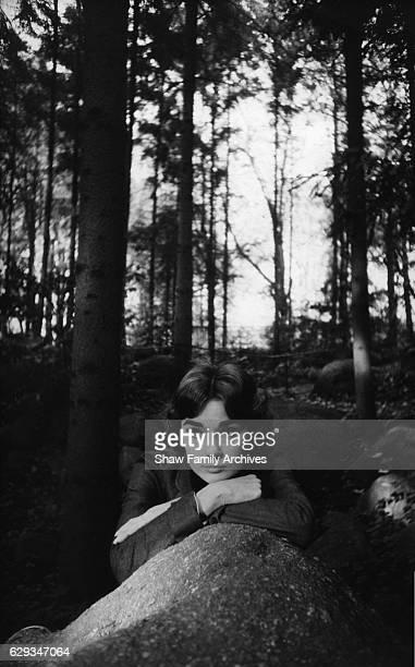 Audrey Hepburn leans on a rock in the Bois de Boulogne in 1957 in Paris France