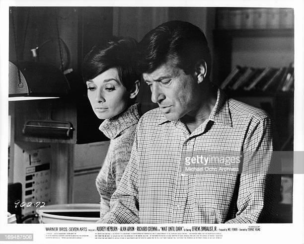 Audrey Hepburn looks over the shoulder of Efrem Zimbalist Jr in a scene from the film 'Wait Until Dark' 1967