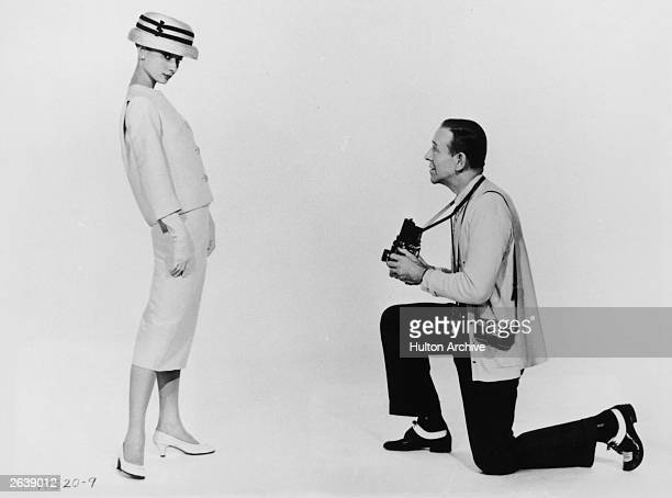 Audrey Hepburn models for fashion photographer Fred Astaire in the Paramount film 'Funny Face' directed by Stanley Donen