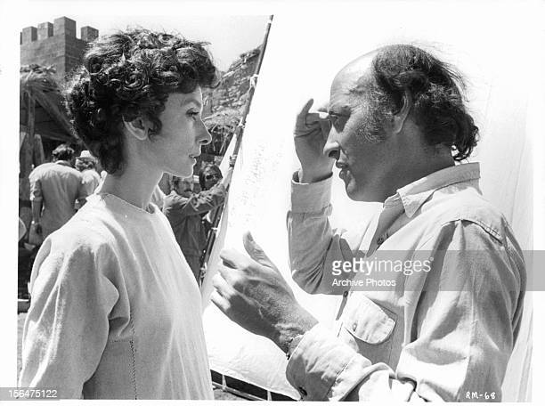 Audrey Hepburn takes direction from Richard Lester in between takes of the film 'Robin And Marian' 1976