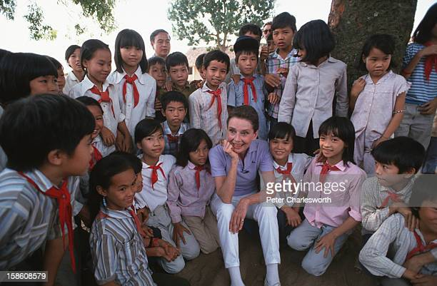 Audrey Hepburn, UNICEF's Goodwill Ambassador, takes time to get to know some schoolchildren in uniform in a small village close to Hanoi..