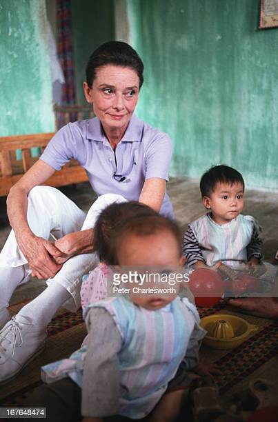 Audrey Hepburn, UNICEF's Goodwill Ambassador, visits very young children in a daycare center on the outskirts of Hanoi..