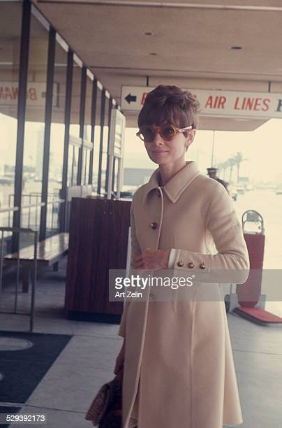 Audrey Hepburn wearing a beige wool coat and sunglasses at the airport April 1st 1968 New York