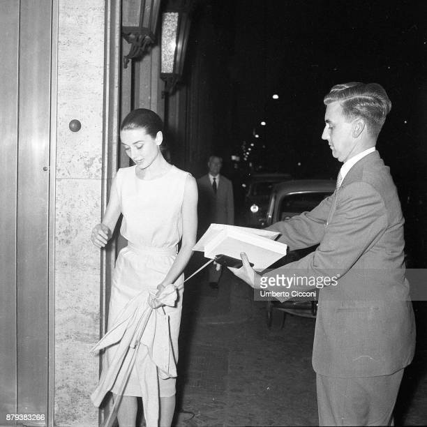 Audrey Hepburn with her halfbrother Ian Quarles van Ufford at the Hassler hotel Rome 1958