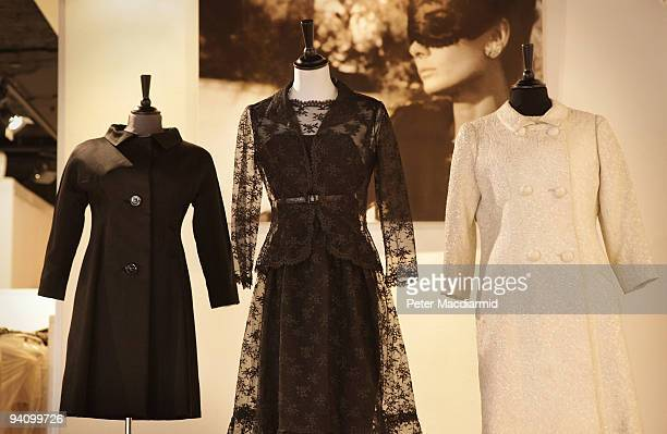 Audrey Hepburn's 1967 black silk evening coat and a black chantilly lace cocktail dress worn in the 1966 film 'How to Steal a million' is displayed...