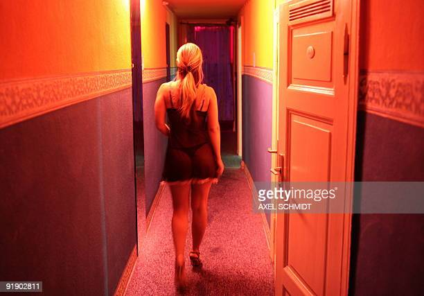 Audrey KAUFFMANN GERMANYSEXCLIMATE FILES Picture taken on September 12 2007 shows a prostitute walking towards a room in a brothel in an apartment in...