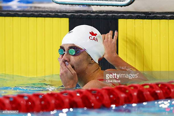 Audrey Lacroix of Canada reacts after winning the gold medal in the Women's 200m Butterfly Final at Tollcross International Swimming Centre during...