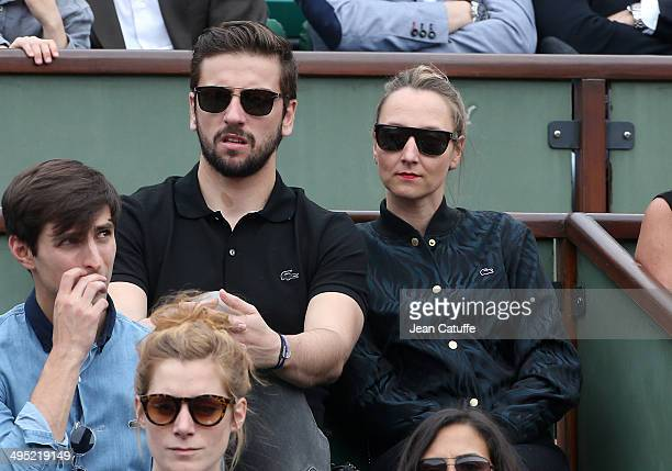 Audrey Lamy and her boyfriend Thomas Sabatier attend Day 8 of the French Open 2014 held at RolandGarros stadium on June 1 2014 in Paris France