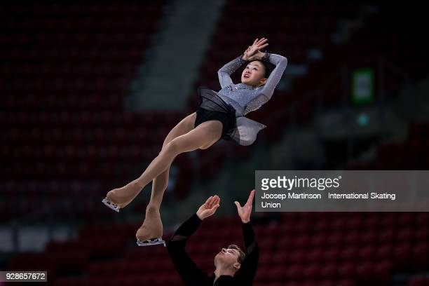 Audrey Lu and Misha Mitrofanov of the United States compete in the Junior Pairs Short Program during the World Junior Figure Skating Championships at...