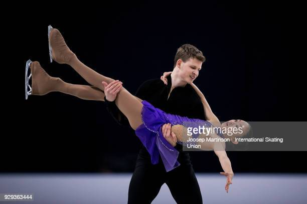 Audrey Lu and Misha Mitrofanov of the United States compete in the Pairs Free Skating during the World Junior Figure Skating Championships at Arena...