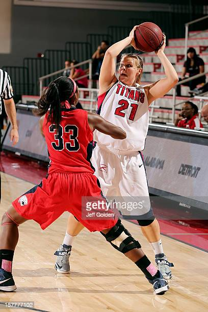 Audrey Matteson of the Detroit Titans looks to pass the ball against Mansa El of the South Alabama Jaguars at The Matadome on November 24 2012 in...