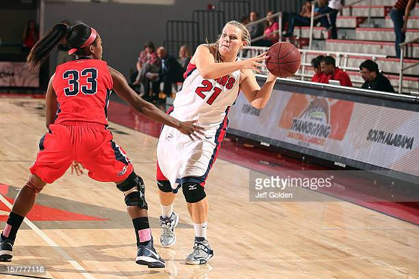 Audrey Matteson of the Detroit Titans passes against Mansa El of the South Alabama Jaguars at The Matadome on November 24 2012 in Northridge...