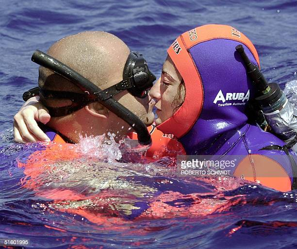 Audrey Mestre Ferreras is congratulated by her husband and freediving master Pipin moments after she reached the surface of the ocean off the coast...