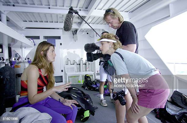 Audrey Mestre Ferreras is interviewed by a National Geographic TV crew off the coast of Ft. Lauderdale 19 May before she succesfully completed a dive...