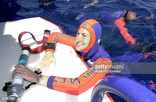 Audrey Mestre Ferreras smiles as she holds a depth gauge off the coast of Ft. Lauderdale 19 May 2001, after she succesfully decended to a depth of...