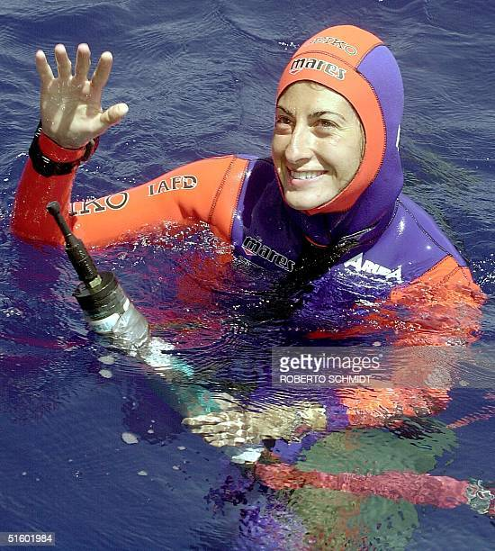 Audrey Mestre Ferreras smiles while holding on to a depth gauge moments after she reached the surface of the ocean off the coast of Ft. Lauderdale 19...