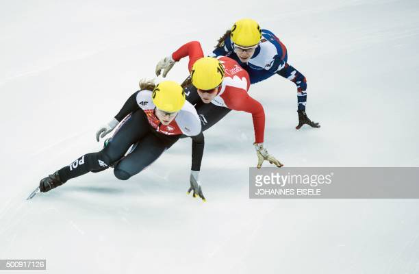 Audrey Phaneuf of Canada Emina Malagich of Russia and Lee EunByul of South Korea compete in the women's 500m heat at the ISU World Cup Short Track...