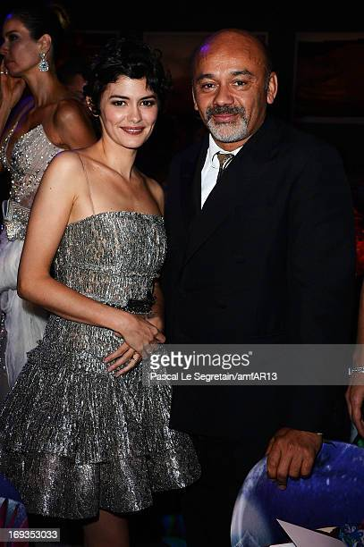 Audrey Tautou and Christian Louboutin attend the amfAR's 20th Annual Cinema Against AIDS during The 66th Annual Cannes Film Festival at Hotel du...