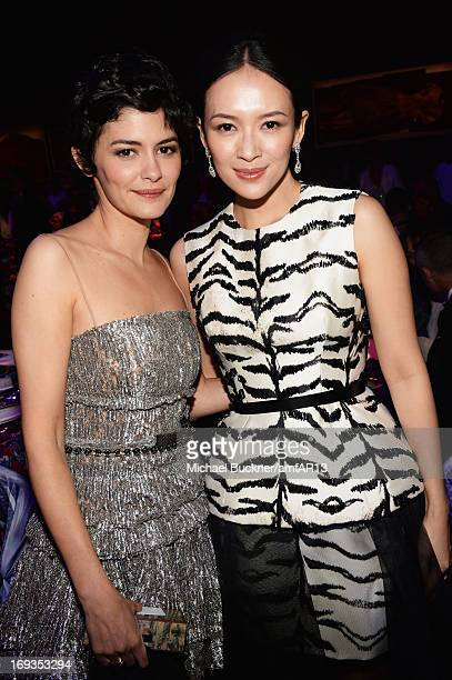 Audrey Tautou and Zhang Ziyi attend the amfAR's 20th Annual Cinema Against AIDS during The 66th Annual Cannes Film Festival at Hotel du CapEdenRoc on...