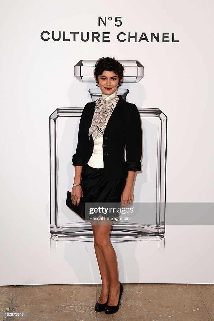 Audrey Tautou poses during a photocall for 'N°5 Culture Chanel' exhibition at Palais De Tokyo on May 3, 2013 in Paris, France.
