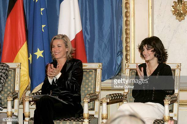 Audrey Tautou waits alongside Laurence Ferrari at a ceremony in which she and Daniel Bruehl received the Adenauer-de-Gaulle prize January 21, 2005 at...