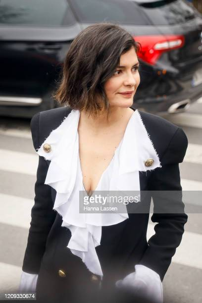 Audrey Tautou wearing Balmain black blazer and white frill blouse outside the Balmain show during the Paris Fashion Week Womenswear Fall/Winter on...