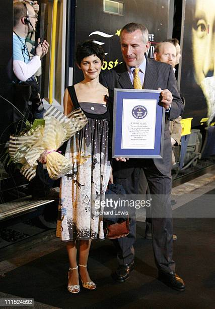 Audrey Tautou with Guinness World Records representative