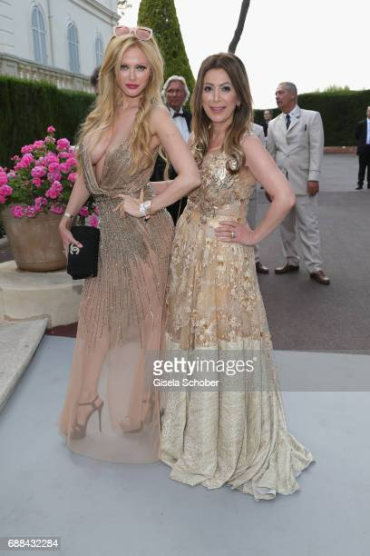 Audrey Tritto and guest arrive at the amfAR Gala Cannes 2017 at Hotel du CapEdenRoc on May 25 2017 in Cap d'Antibes France