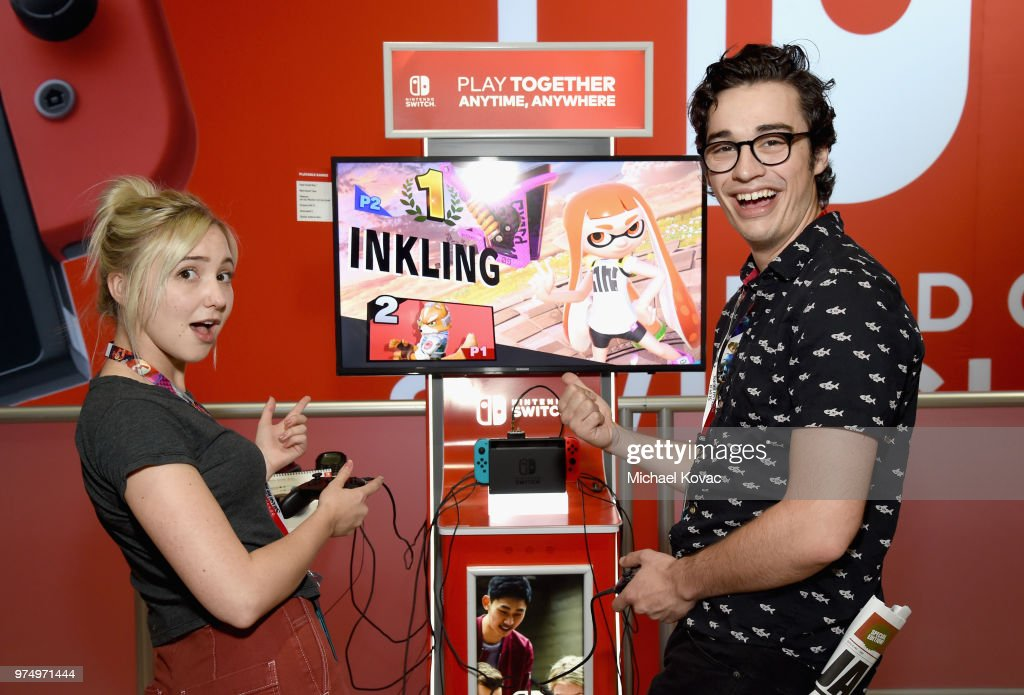 Audrey Whitby (L) and Joey Bragg get a look at the Super Smash Bros. game on the Nintendo Switch system during the 2018 E3 Gaming Convention at Los Angeles Convention Center on June 14, 2018 in Los Angeles, California.
