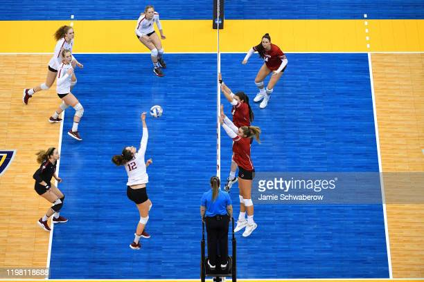 Audriana Fitzmorris of the Stanford Cardinal hits a kill against the Wisconsin Badgers during the Division I Women's Volleyball Championship held at...
