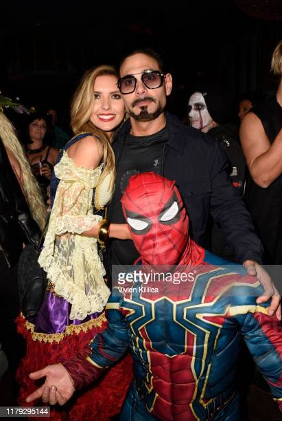 Audrina Partridge and Eric Podwall attend Podwall Entertainment's 10th Annual Halloween Party presented by Maker's Mark on October 31 2019 in West...