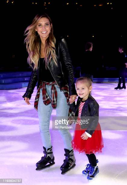 Audrina Patridge and daughter Kirra attend Disney On Ice Presents Mickey's Search Party Holiday Celebrity Skating Event at Staples Center on December...