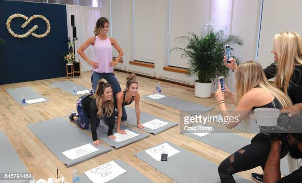 Audrina Patridge Bohan Becca Tilley and Christine Andrew warm up before their workout with CALIA lead designer Carrie Underwood and her road trainer...