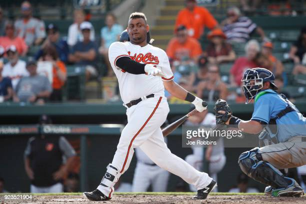 Audry Perez of the Baltimore Orioles loses his helmet as he strikes out against the Tampa Bay Rays in the ninth inning during a Grapefruit League...