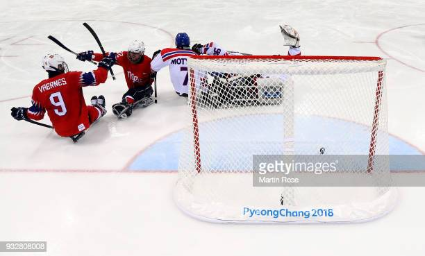 Audun Bakke of Norway celebrates a goal with team mate Morten Vaernes in the Ice Hockey classification game between Norway and Czech Republic during...