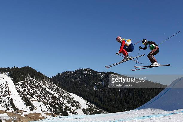Audun Groenvold of Norway and Christopher Delbosco of Canada compete in the men's ski cross race big final on day ten of the Vancouver 2010 Winter...