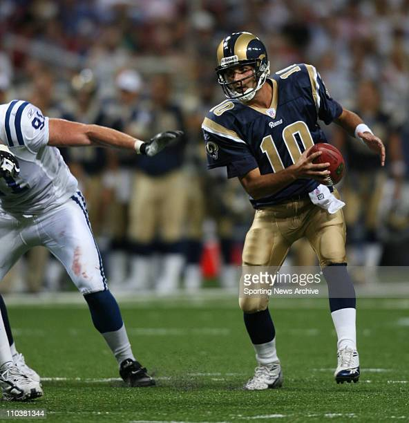 Aug 10 2006 St Louis MO USA Rams quarterback MARK BULGER evades pressure The Indianapolis Colts at the St Louis Rams during pre season action at the...