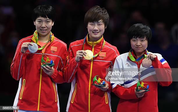 JANEIRO Aug 10 2016 Gold medalist China's Ding Ning center silver medalist China's Li Xiaoxia left bronze medalist Kim Song I of the Democratic...