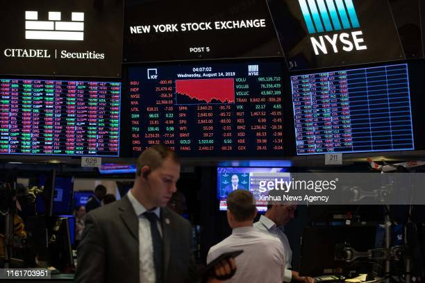Aug. 14, 2019 -- Traders work at the New York Stock Exchange in New York, the United States, Aug. 14, 2019. U.S. Stocks closed remarkably lower on...