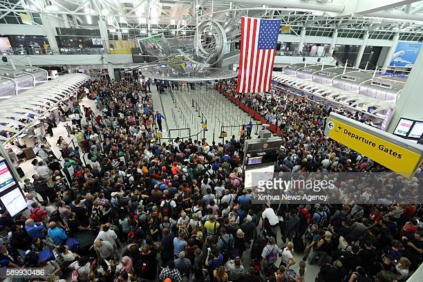 NEW YORK Aug 15 2016 People wait for the reopening of the security check at the JFK International Airport in New York the United States on Aug 15...