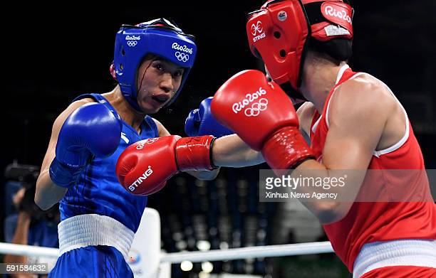 JANEIRO Aug 16 2016 China's Ren Cancan left competes against Canada's Mandy Bujold during women's fly KG quarterfinal of boxing at the 2016 Rio...