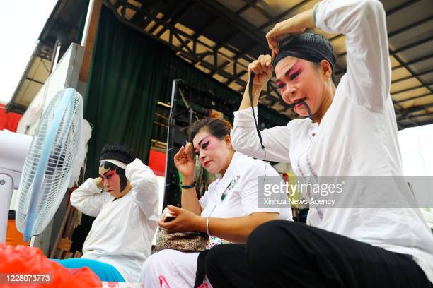 Aug. 16, 2020 -- Members of a traditional Yu Opera troupe make up before their performance in east China's Anhui Province, Aug. 16, 2020. The local...