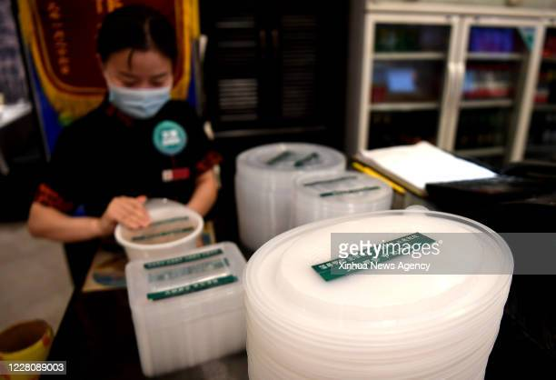 Aug. 17, 2020 -- Photo taken on Aug. 17, 2020 shows takeout boxes with notices that remind customers not to waste food at a restaurant in Qiaoxi...